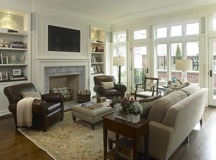 Living Room Decorating Ideas on a Budget - Classy and Neutral Family Room (furniture  arrangement) Like the bookcases on either side of the fireplace.