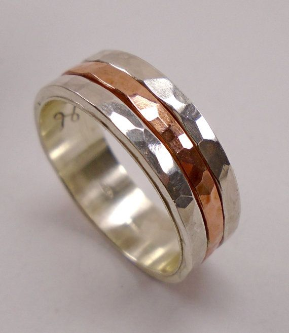 Engagement sterling silver ring with faceted hammered, center of copper and custom text.  The customer can request a text on the inside of the ring. You can enjoy the copper while not having to worry about stained fingers, because the sterling silver liner on the inside of the ring band will protect your fingers of copper stains.  <<<< The width of the ring is 7-8 mm. If you want two rings check out my other publication because the price of a pair of rings is lower.