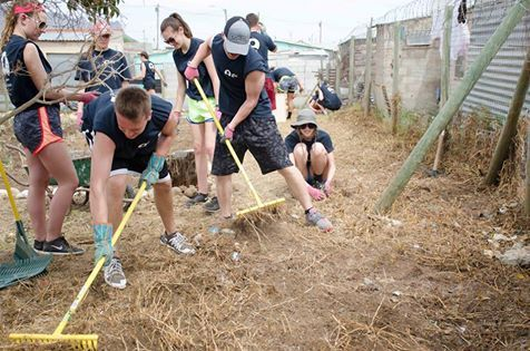 Our volunteers in Cape Town are clearing the ground to make room for a vegetable garden!
