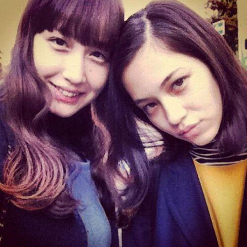 with her sister, Yuka