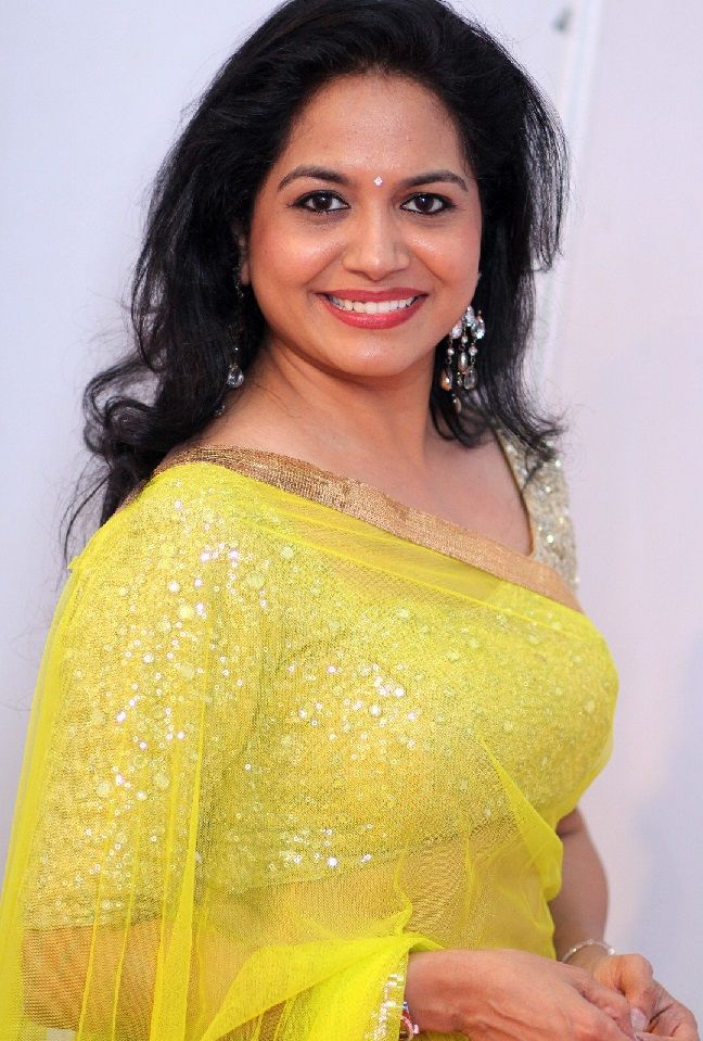 Indian Singer Sunitha Long Hair Stills In Transparent Yellow Saree