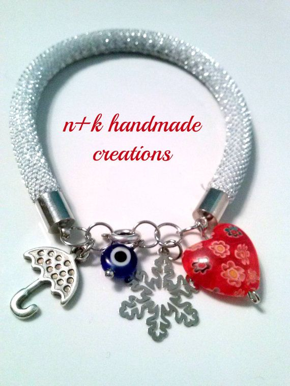 Handmade bracelet made of thick silver string. by thenkcreations