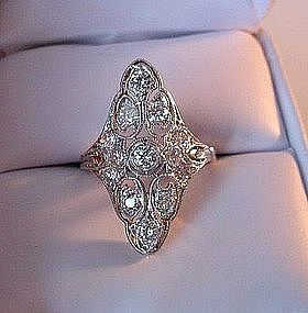 Antique Filigree ring --  My Grandmother had a ring similar to this that was stolen with all her other rings. The were all very deco looking.