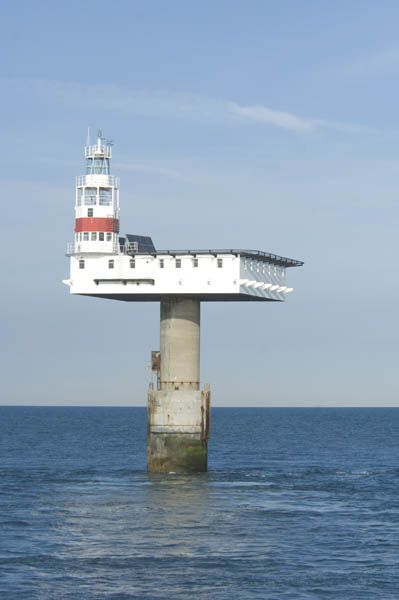 Royal Sovereign lighthouse (built 1971), marking Royal Sovereign shoal approx. 6 miles ESE of Eastbourne, Sussex, southern England (in English Channel). Replaced lightvessel moored over shoal since 1875. 12-nautical mile light flashes every 20 seconds. Remotely controlled by Trinity House from Harwich, Essex. Photo: http://www.photographers-resource.co.uk