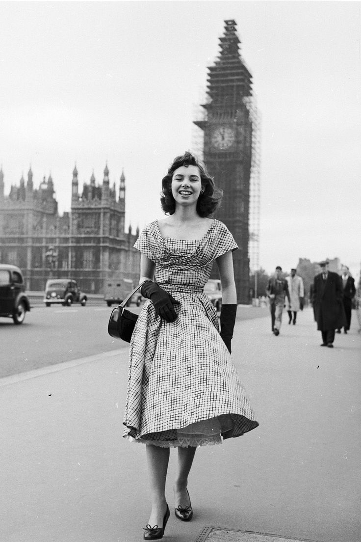 1956 Marigold Russell models a new outfit outside London's Big Ben.