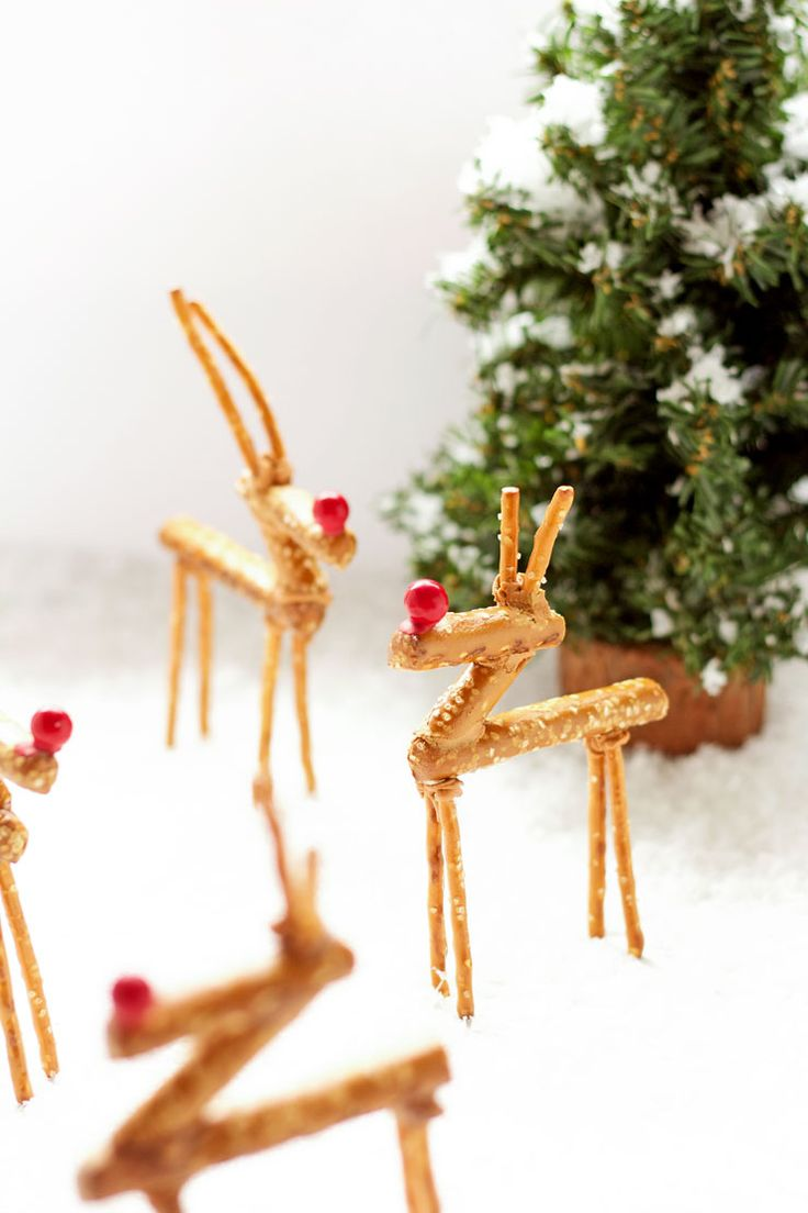 Pretzel Reindeer are a good addition to your Christmas table decorations. They're made with pretzels and icing. So simple the kids can help make them.