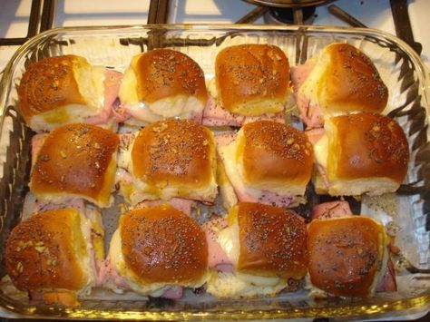 The Best Ham Sandwiches Ever - 2 -12 packages of sweet hawaiian rolls (the small dinner roll looking ones) 1 1/2 lbs of virginia ham (NOT honey ham) 12 slices swiss cheese 3/4 cup butter 1 1/2 teaspoons Dijon mustard 1 1/2 teaspoons Worcestershire sauce 1 1/2 teaspoons dried onions poppy seed