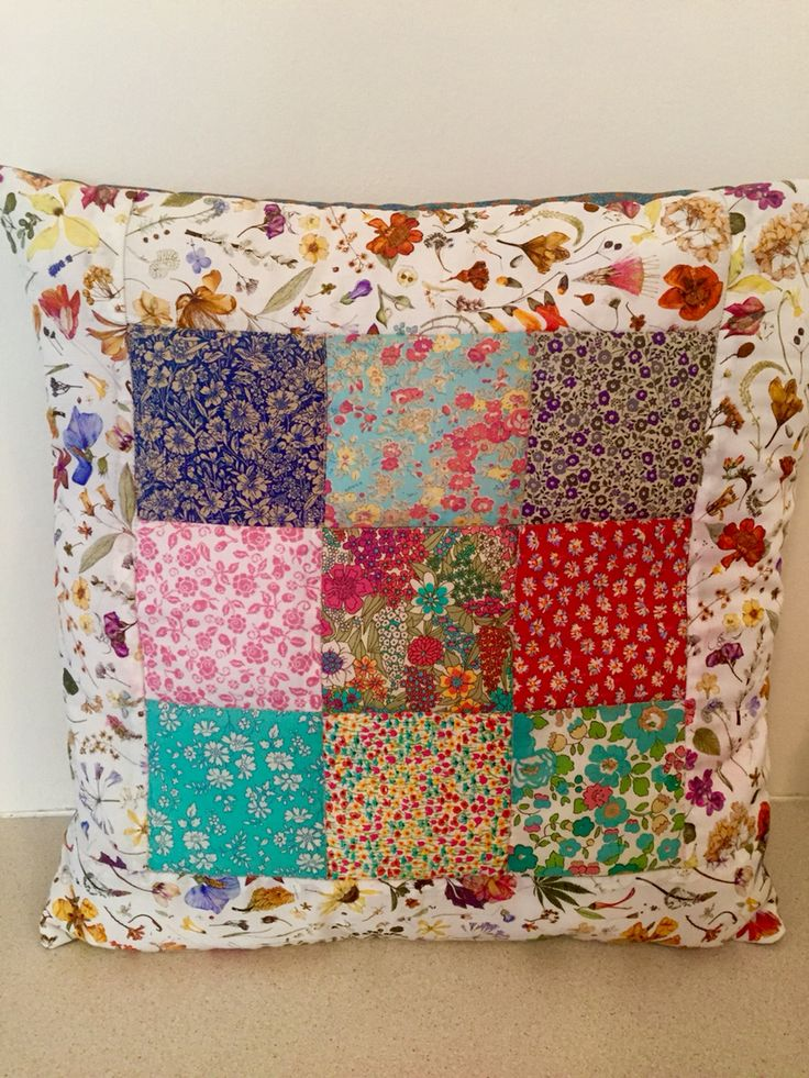 Patchwork quilted cushion made using scraps of Liberty fabric