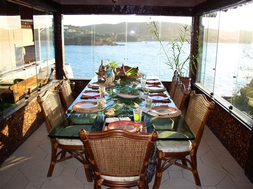 Dine on breakfast with a view of the sea at Cachoeira Inn in Buzios, Brazil