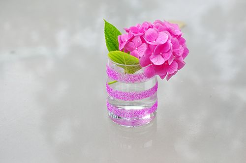 DIY Striped Glitter Vase. Turn a plain old vase or cup into a fun and pretty centerpiece!