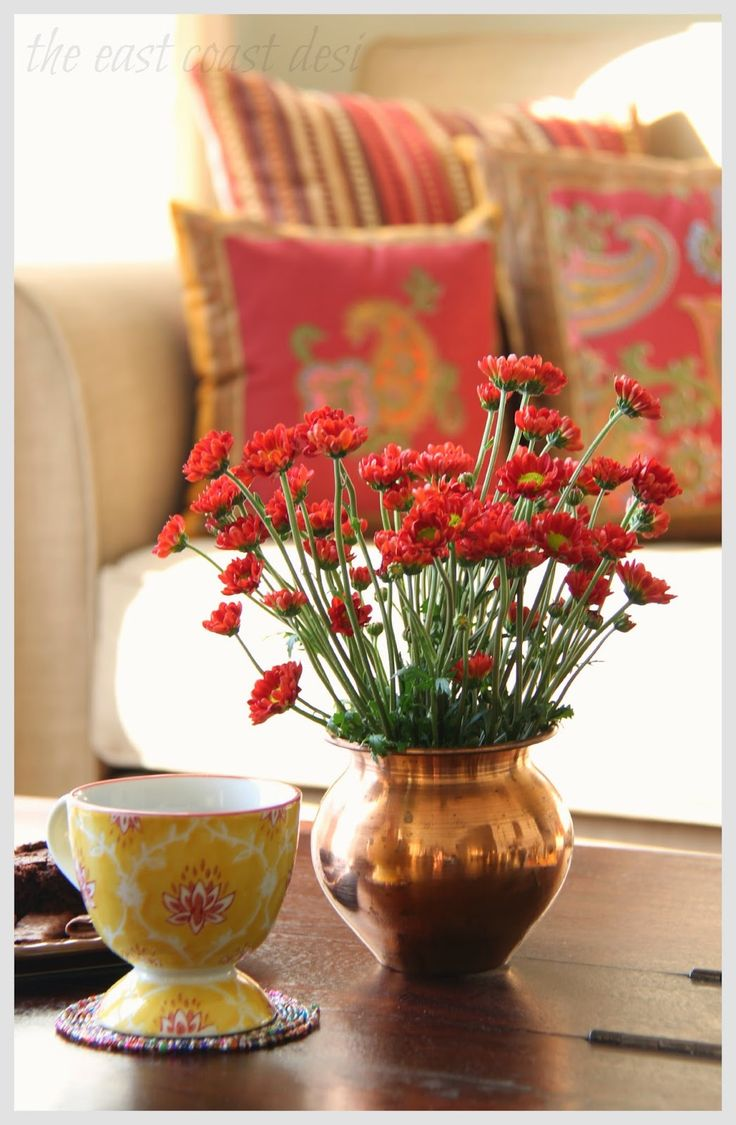 Aalayam - Coffee table decor with brass or copper pots holding flowers