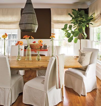 Roman shades made from burlap ensure that the window treatments in this dining room are as laid-back as the rest of the space.