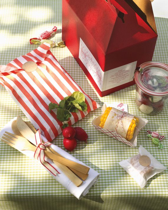 Serve classic picnic staples, dialed up a notch. Package everything separately, in glass, glassine, or paper, so it will stay fresh for several hours; this also lets guests eat neatly out of hand.Choose a crusty bread for the sandwiches that won't get soggy, and use leakproof canning jars for a tomato and mozzarella salad. Tie disposable bamboo utensils for your hungry guests to a linen napkin with ribbon.