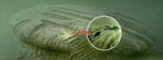 """""""The circle is 80 meters deep. The object as above is circular and has a diameter of 60 meters and It looks like a staircase to the left based on the divers' videos and other observations. Our studies show that the object is separated from the bottom. It is located on a ridge or a hill, with steep slopes on the sides. During the last expedition it was confirmed that there is a wedge formed gap between the upper part (the circle) and the lower part (foundation/pillar)."""