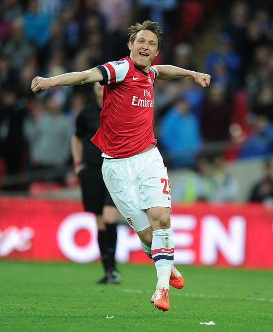 Kim Kallstrom celebrates scoring his penalty in the shoot out, FA Cup Semi Final. Wigan Athletic (Pen. 2-4) Arsenal (April 2014) by Stuart MacFarlane