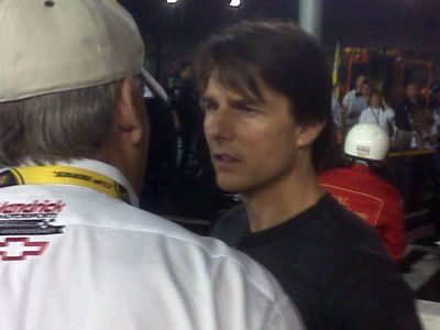 Tom Cruise chats with team owner Rick Hendrick on pit road prior to the Chevy Rock & Roll 400 at Richmond International Raceway.