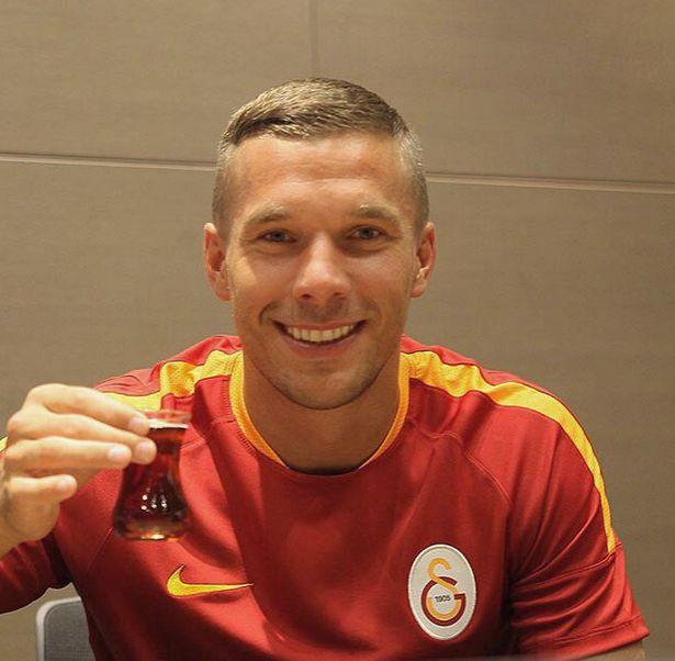 Lukas Podolski celebrates signing for Galatasaray