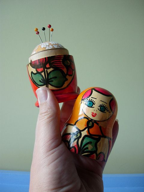 "A matryoshka doll pin cushion. I would like the painting to be more like the original matryoshka or something completely different, perhaps some ""nerdy"" pattern but I love the idea <3"