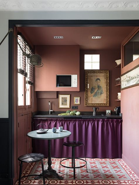 This Parisian Designer Brings Overwhelming Beauty to Small Spaces — 1stdibs IntrospectiveThe kitchen area of another apartment Evennou designed in the 16th — this one a studio just under 260 square feet — makes a statement with simple antique furniture, graphic cement floor tiles from Carocim and paintings brought back from a trip in China.