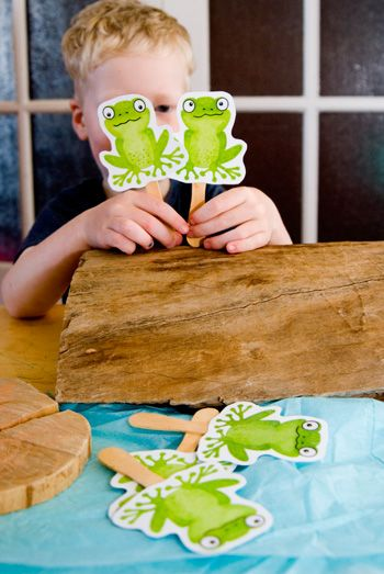 "Printable frog puppets for the song ""Five Little Speckled Frogs."" Great use of an actual log and the blue tissue paper pond."