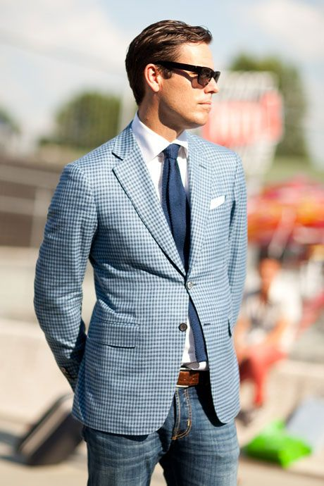 Shop this look on Lookastic:  http://lookastic.com/men/looks/tie-and-dress-shirt-and-blazer-and-pocket-square-and-belt-and-jeans/870  — Navy Knit Tie  — White Dress Shirt  — Light Blue Gingham Blazer  — White Pocket Square  — Brown Leather Belt  — Blue Jeans