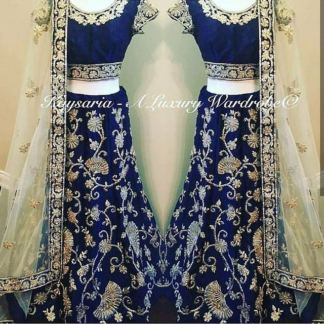 Midnight blue velvet lengha with zari embroidery highlighted with topaz crystals Paired with a champagne gold dupatta, with a machine embroidered border. Code : S341 Title : Midnight blue machine embroidery lehenga choli with sequins embellished. Size : Free Color : Midnight Blue Fabric : Velvet Type : Embroidered Occasion : Festive, Wedding, Ceremony, Party Neck Type : Round Neck Sleeve Type : Short Sleeve Price : 3600 INR Only ! #Booknow CASH ON DELIVERY Available In India ! World Wide…
