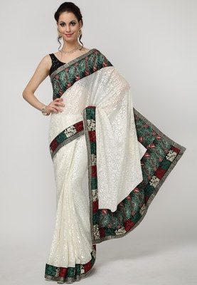 Cream coloured embroidered saree for women from Dori. Made form brasso, the saree measures 5.5 m and comes with a blouse piece of 0.80 m. This saree from Dori is a great pick for social gatherings. Cream colour renders this saree a modern look. Club this ethnic wear with selective accessories and spread the air of elegance.