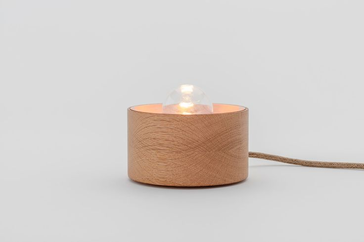 Candil Madrid. Made of brass and copper acting as conductors and wood  as an insulator.