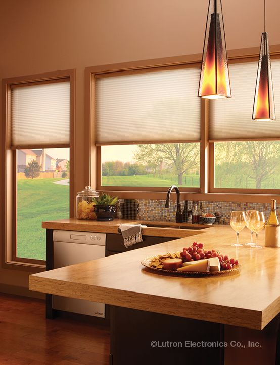 Automated shades from Lutron move in precise alignment, for a clean look.  www.