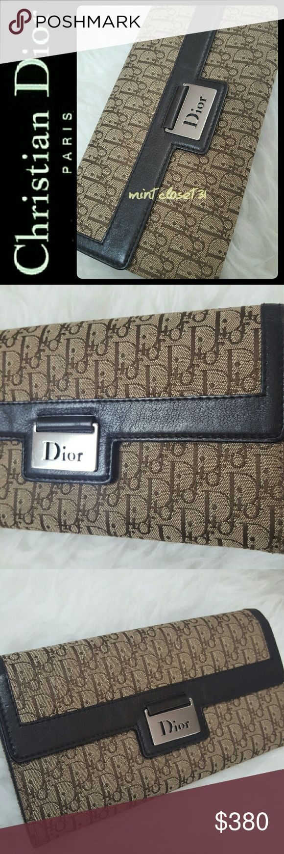 Christian Dior Italy Canvas Leather Wallet DIOR by Christian Dior Designer Wallet! Stunning Monogram Design Impregnated on Coated Canvas with Leather Trim! Features the Iconic DIOR Logo Print Embed Cutout on Silver Hang Tag on Front Flap Snap Button Closure!   Known for Luxury Staple Pieces, this DIOR Wallet Opens to Fully Lined Interior with Zipped Pocket for Coins! Multiple Bill and Storage Compartments with 6 Cards Slots! Matching Crossbody Bag on Separate Listing in my Closet! Bundle for…