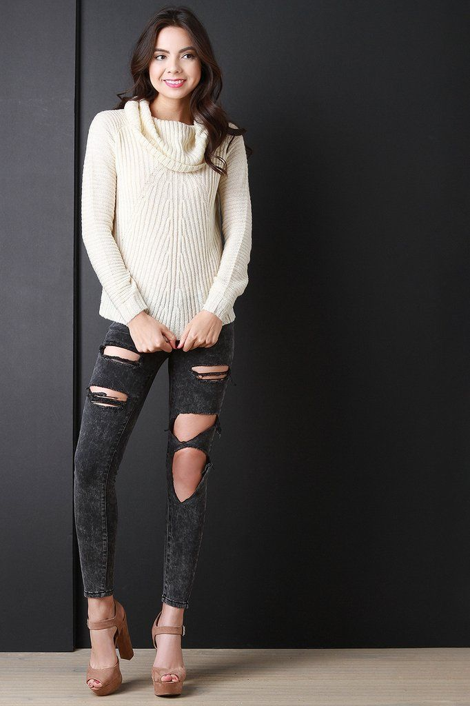 This sweater features ribbed knit design, cowl neckline, long sleeves, and a vent slit opening at back. Accessories sold separately. 100% Acrylic.