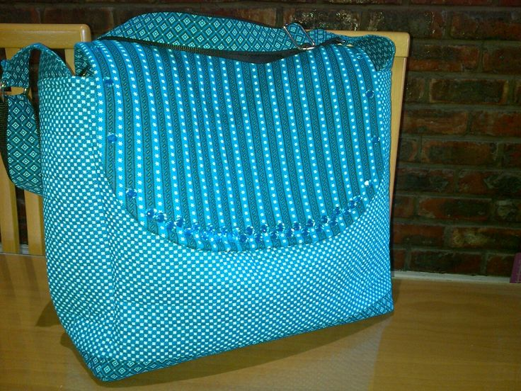 Handmade babybag turkoise shweshwe