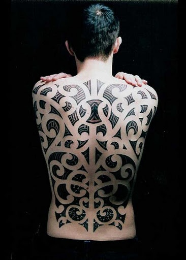 .}Tattoo{. Looks like a mix of Maori & something else.