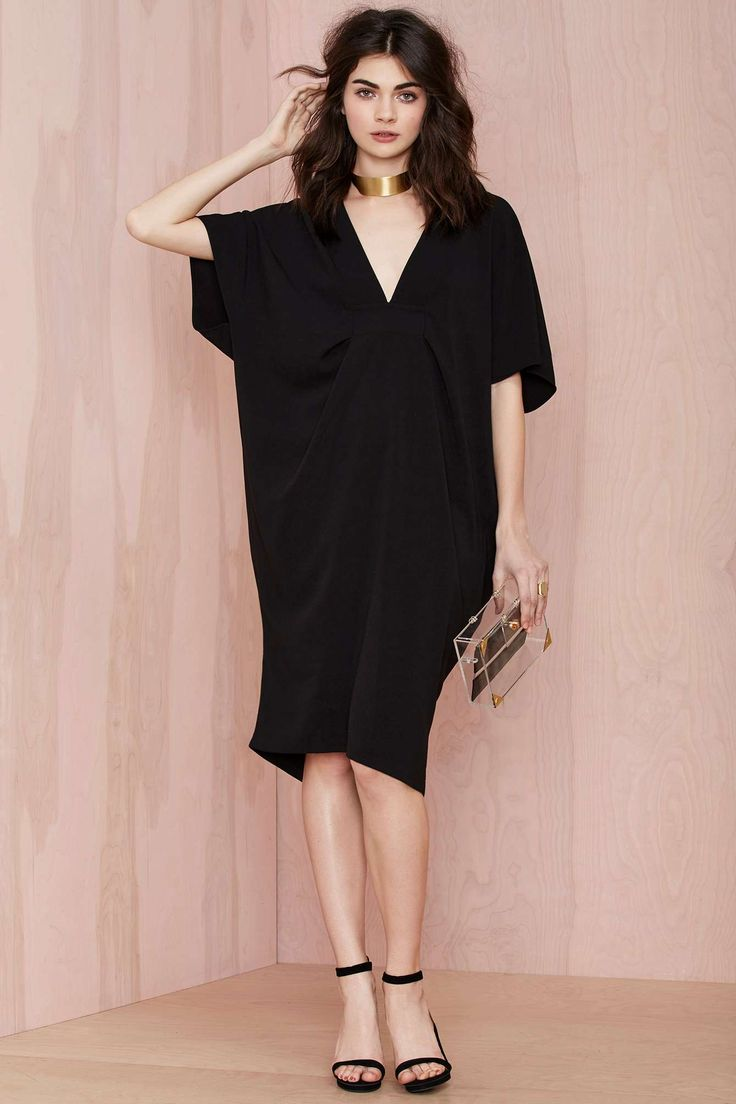 All of the Night Caftan Dress with cute back cutouts.