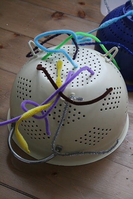 Colander and pipe cleaner fine motor activity.