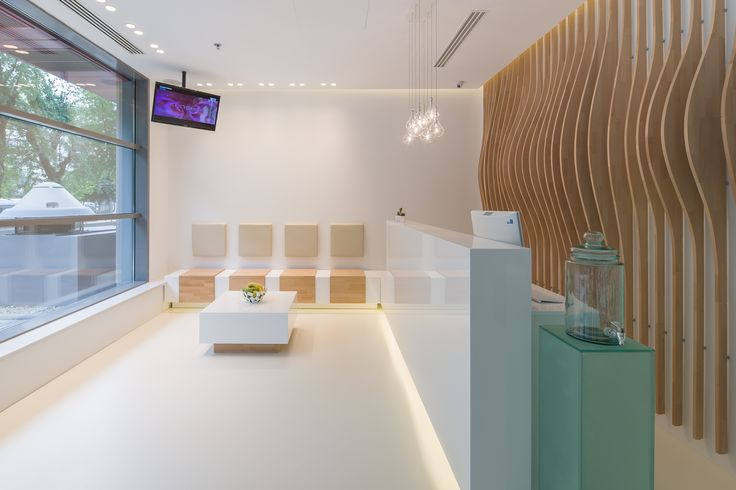 minimalist reception with sitting area - materials: glossy white MDF, glass, oak orders/price offers at: office@liniafurniture.ro