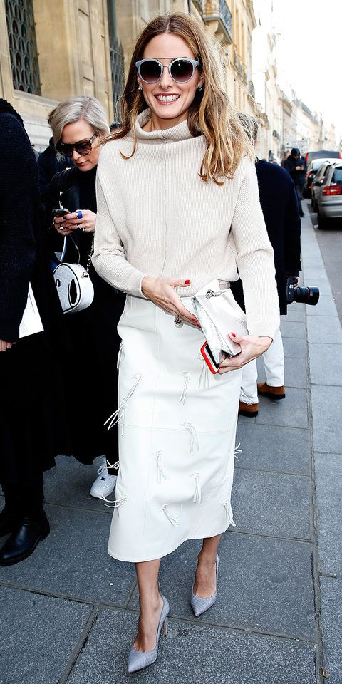 Olivia Palermo wore a slouchy oatmeal turtleneck that she tucked into a white leather midi-length pencil with fringe detailing. Round shades, a white clutch, and lavender pumps completed her pastel-perfect ensemble.