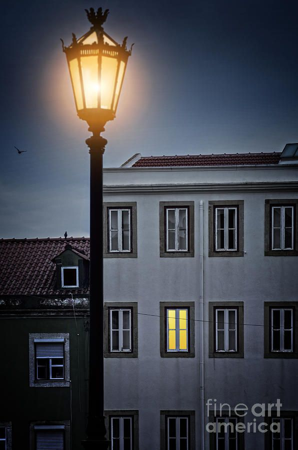 Picturesque Lisbon neighborhood with houses at night in Portugal