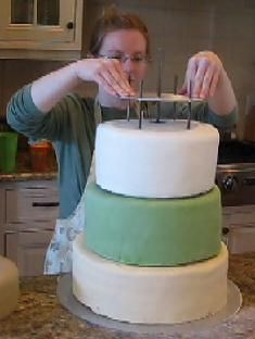 Stacking tiered wedding cake