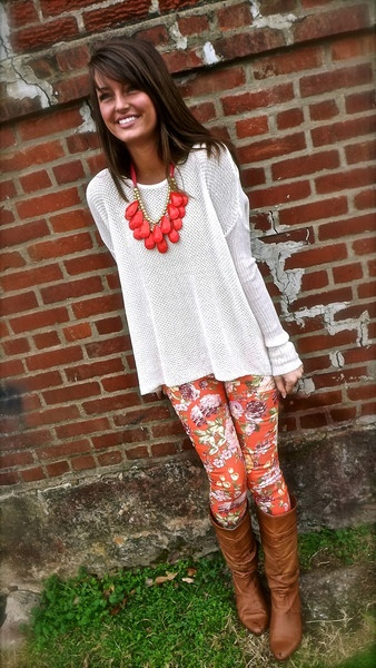 Loose-fit tunic / printed leggings / boots / statement necklace. Early spring