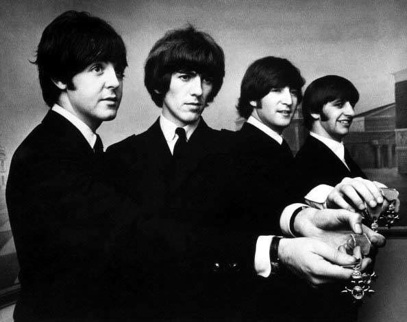 The Beatles showing off their MBE awards from Queen Elizabeth!