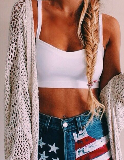 messy fishtail braid + white crop top + american high-waisted denim shorts + over-sized sweater