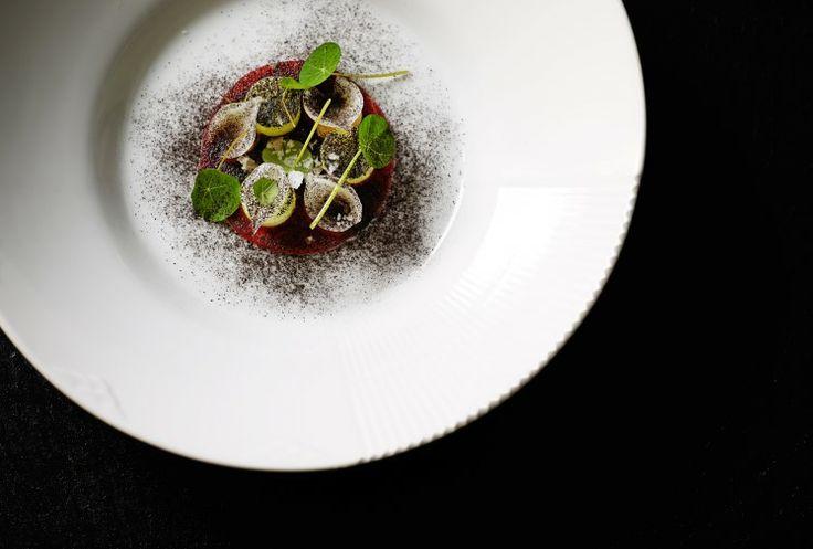Gravad beef with onions at our Michelin star restaurant Kokkeriet, Copenhagen - Denmark.