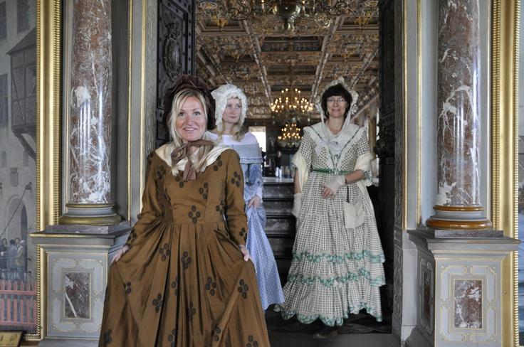 Women in 19th century dresses - leaving The Great Hall