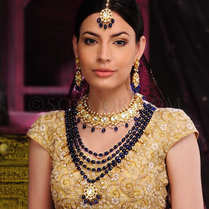 BRI/1/3401 Kiara Bridal Set with includes Necklace, Rani Haar, Maang Tika, and Earrings dull gold finish studded with kundan and blue iolite stones  $888 £524