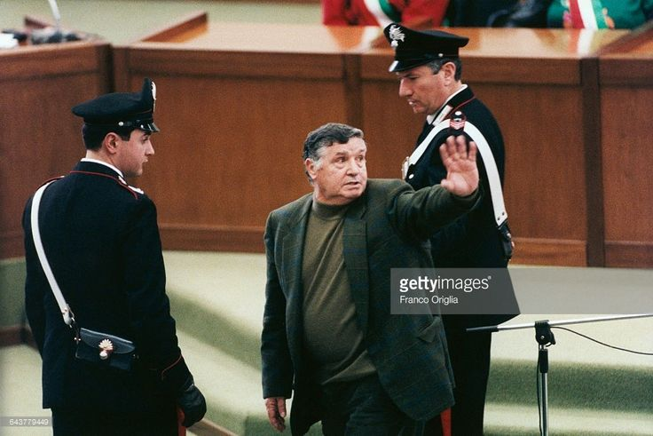 Salvatore Riina, aka Toto Riina, the most important figure of the Sicilian mafia, is brought to justice after evading police for 23 years at the Aula Bunker of Palermo courthouse on March 4, 1993 in Palermo, Italy. Riina, nicknamed 'The Beast', is being judged on almost 150 counts of murder.