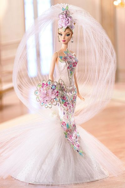 Love the way the veil is done... wonder if I could that for a real life person? (Wedding-day Barbies: Couture Confection Bride Barbie (2006))