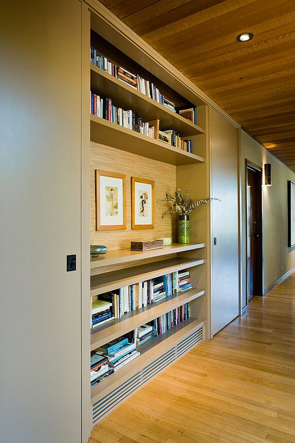 Hallway lined w/ built-in shelves & storage cupboards (note interesting ceiling echoes the floor)