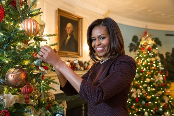 First Lady Michelle Obama poses with the 2014 White House Christmas ornament. Purchase your own official 2014 White House Historical Ornament, honors President Warren G. Harding through our online store: http://www.whitehousegiftshop.com/product-p/2014-whhaorn.htm or call to place an order Monday - Friday 9:00am - 4:30pm 1 (877) 896-3609