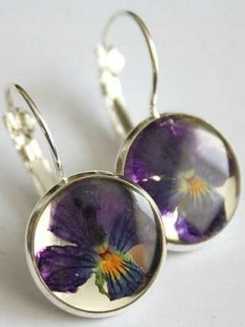 Pansy Earrings | This jewellery features hand picked and pressed plants grown in a greenhouse by the designer herself! Some pieces also feature foraged natural items such as ferns, lichen and moss, leaves, and seashells gathered from Eastern Quebec and the Bas St-Laurent region. #torontofashion #CanadianDesigners #canadianfashion #canadianfashionblogger #madeincanada #canadiandesigner #canadianbrands #jewellery #torontojewelry #canadian #earrings  #madeinquebec